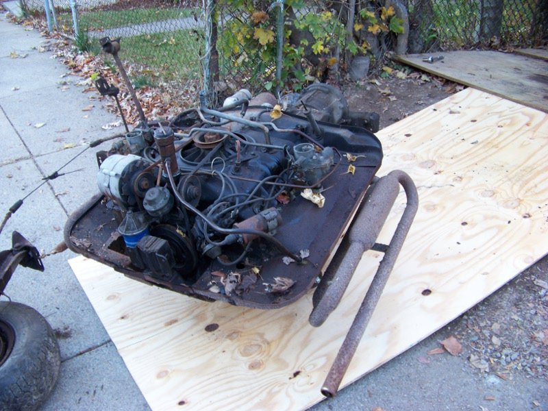 Engine out of the car and on the sidewalk