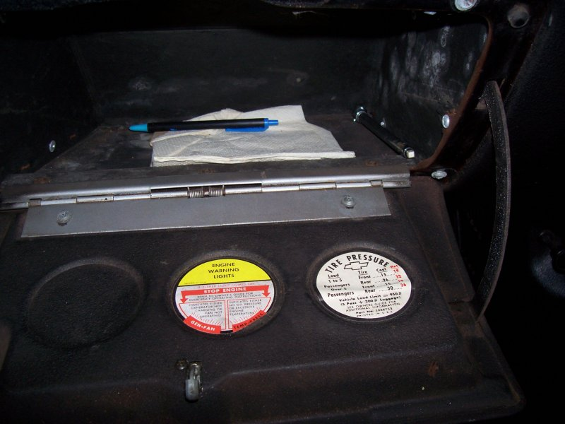The stickers on the glove box