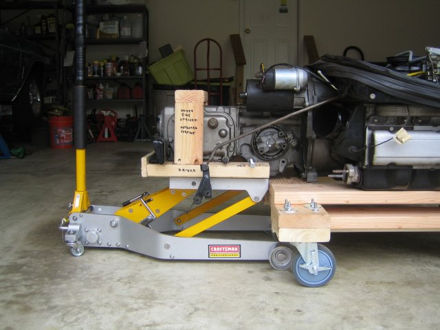 Auxiliary cart for separating transaxle.